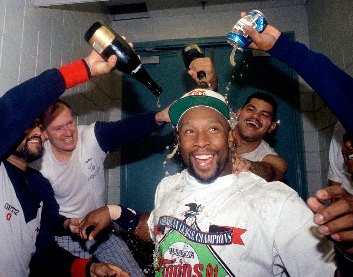 The ALCS MVP, Kirby Puckett gets showered with alcohol by his teammates after the Twins beat the Blue Jays 8-5 to win Game 5.