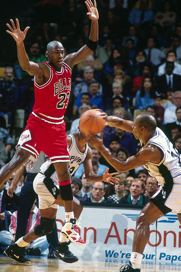 Michael Jordan leaps to intercept a pass against the Spurs in January 1992. Jordan made the NBA All-Defensive First Team that season for the fifth straight time.