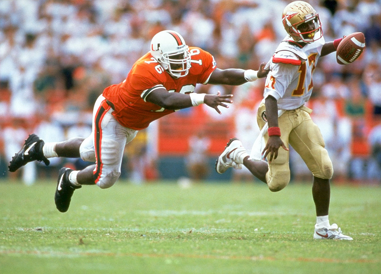 Warren Sapp reaches for Florida State quarterback Charlie Ward on Oct. 3, 1992 in Miami.  The Hurricanes won the game, 19-16.