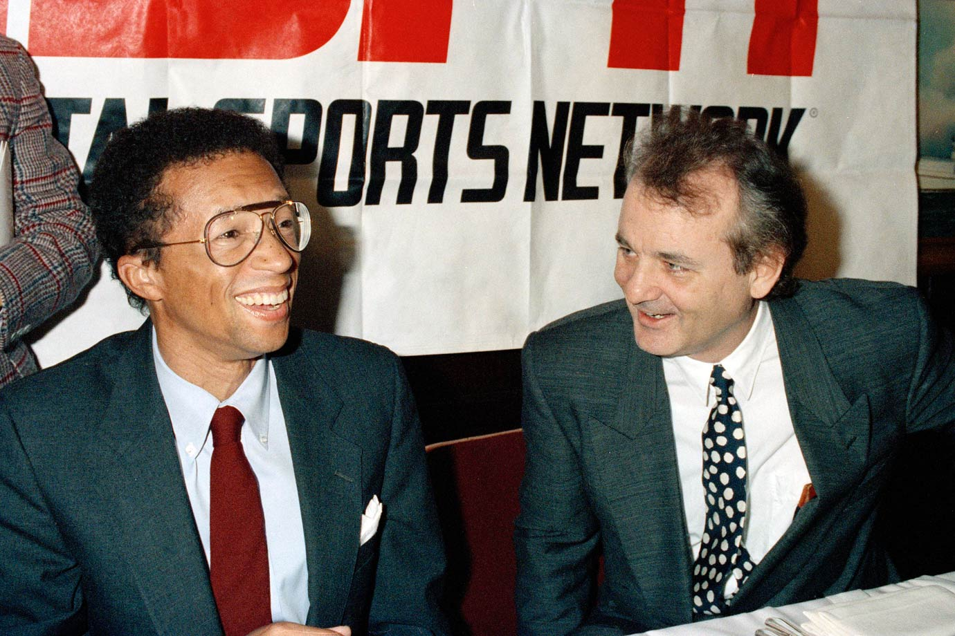 Arthur Ashe and Bill Murray share a laugh prior to a news conference announcing the formation of the ESPY Awards, with some of the proceeds going to the Arthur Ashe Foundation, on Dec. 15, 1992 in New York City.