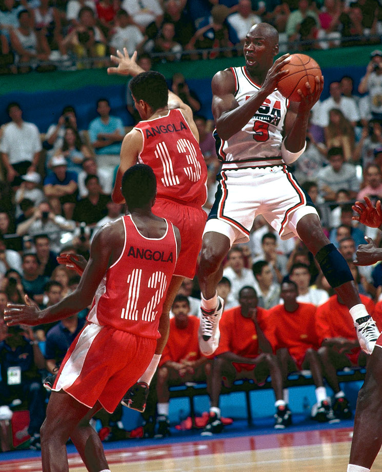Michael Jordan contorts in air to get a shot off against Angola in Team USA's 1992 Summer Olympic matchup in Barcelona. The Dream Team crushed every team it faced, never winning by fewer than 32 points and defeating Angola 116-48. Jordan averaged 14.9 points, second highest on the team.