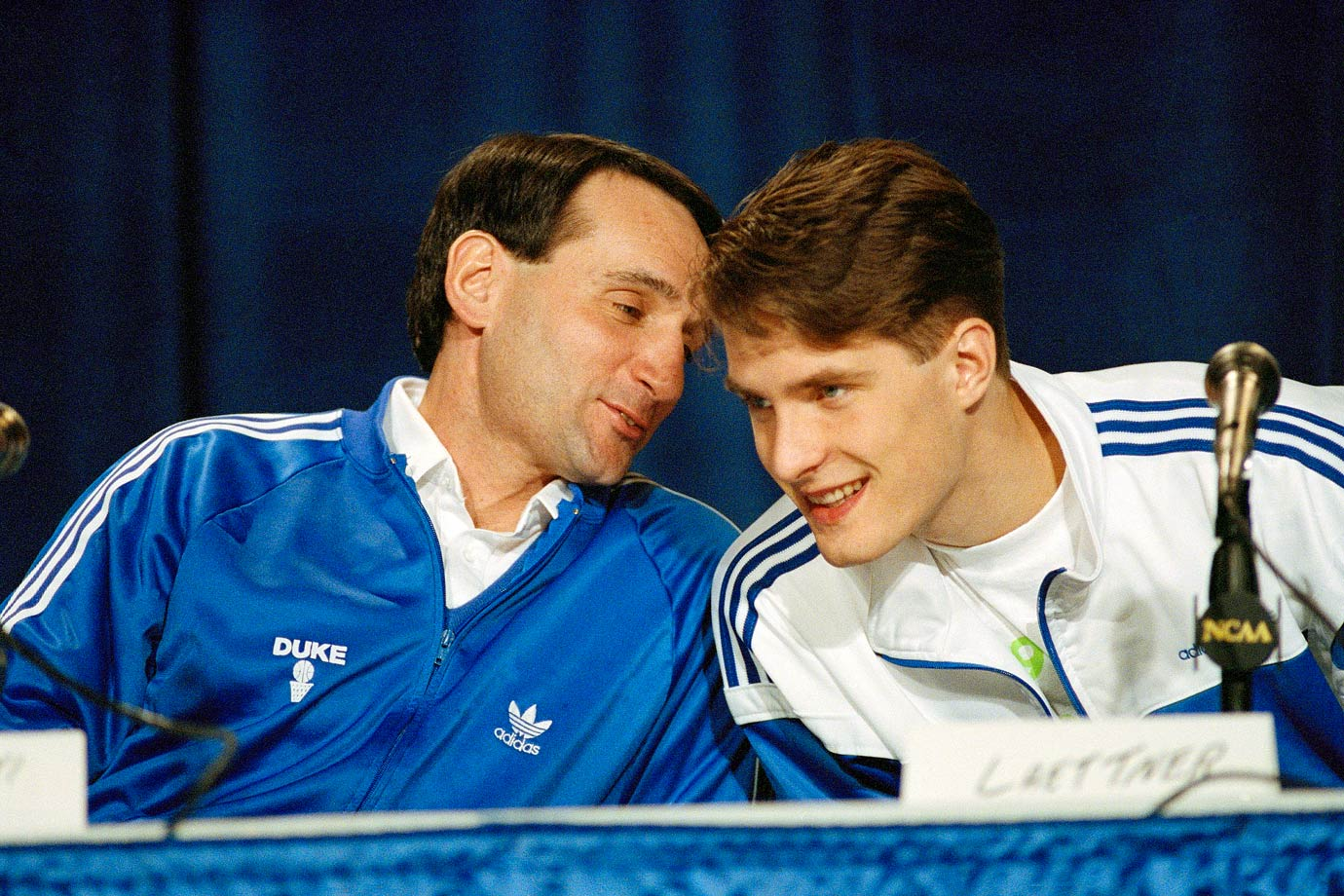 Mike Krzyzewski shares a light moment with Duke forward Christian Laettner during a 1990 news conference. Laettner, the only college player ever to start in four Final Fours, helped Krzyzewski win NCAA titles in 1991 and 1992.