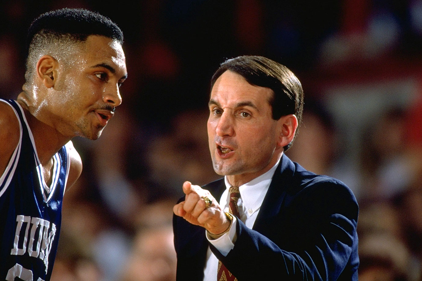 Mike Krzyzewski instructs Grant Hill during a game against NC State in 1992.  In the '92 championship against Kentucky, an unguarded Hill heaved the in-bounds pass 75 feet across the court into the hands of Laettner, who made the game-winning jumper as time expired.