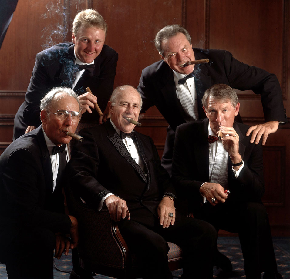 On his 75th birthday, Red Auerbach smokes cigars with his former Celtics players Tommy Heinson, Larry Byrd, John Havlicek and Bob Cousy in Boston.