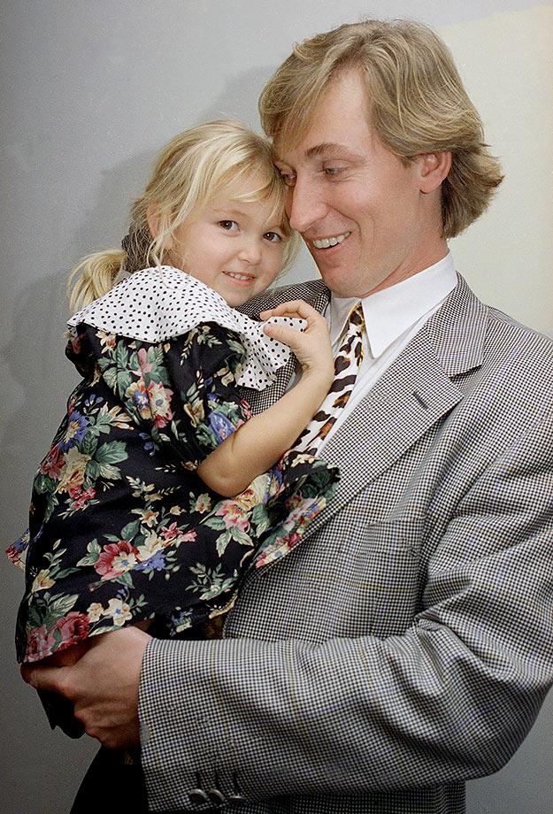 Wayne Gretzky holds his four-year-old daughter, Paulina, after a press conference in Inglewood, Calif., on Jan. 4, 1993. It was announced that the Los Angeles Kings team doctors cleared Gretzky, who hadn't played all season due to a herniated thoracic disk in his back, to return to the game.