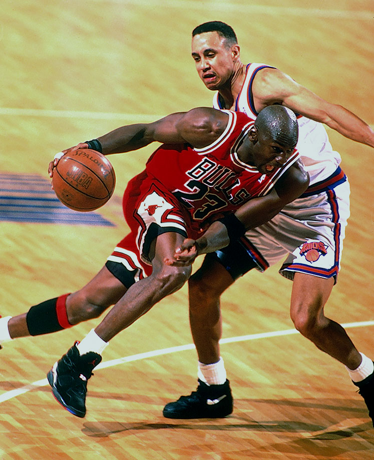 Michael Jordan drives against the New York Knicks in the 1993 NBA Playoffs. After winning a third straight NBA title, Jordan stunningly retired from basketball, saying he had lost his desire to play.