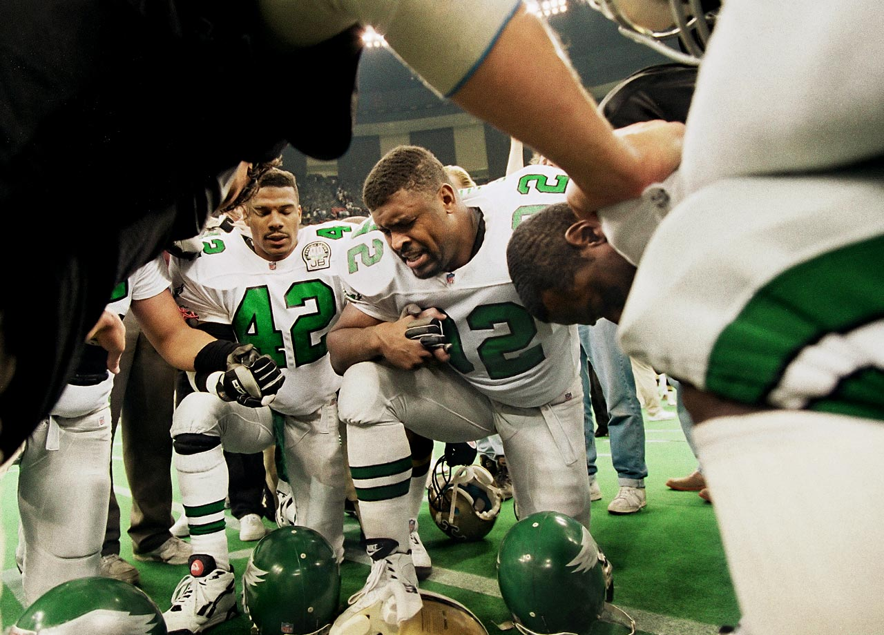 Philadelphia Eagles DE Reggie White leads his teammates with a prayer before their NFC playoff game against the New Orleans Saints on Jan. 3, 1993 in New Orleans.