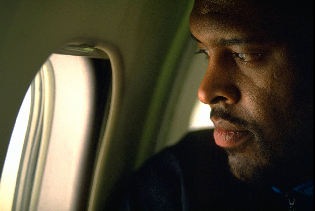 Free agent DE Reggie White looks out an airplane window on March 6, 1993 as he arrives in Cleveland, Ohio.