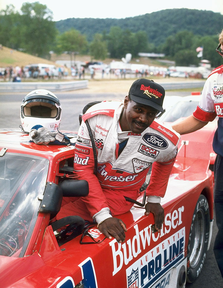 Payton gets into his car before a race on July 24, 1993 at Lime Rock Park, Conn.