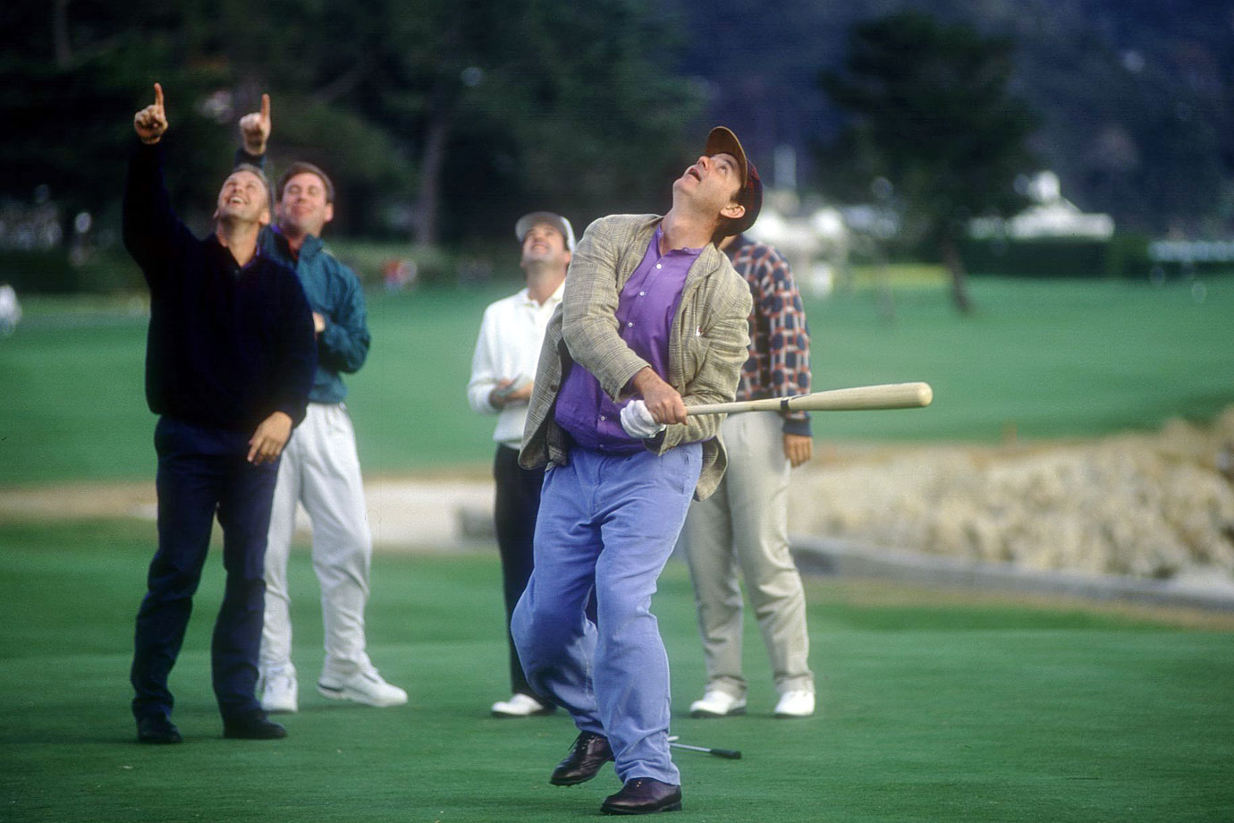 Bill Murray pops up his golf ball with a baseball bat on the 18th green of the AT&T Pebble Beach National Pro-Am golf tournament on Feb. 5, 1994 at Pebble Beach, Calif.