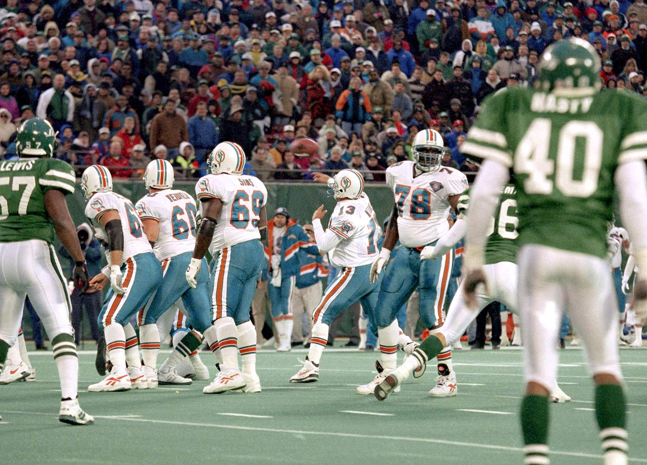 Dan Marino throws a game-winning touchdown pass after faking a spike in the Miami Dolphins game against the New York Jets at Giants Stadium in East Rutherford, N.J. on Nov. 27, 1994.  The Dolphins won the game, 28-24.