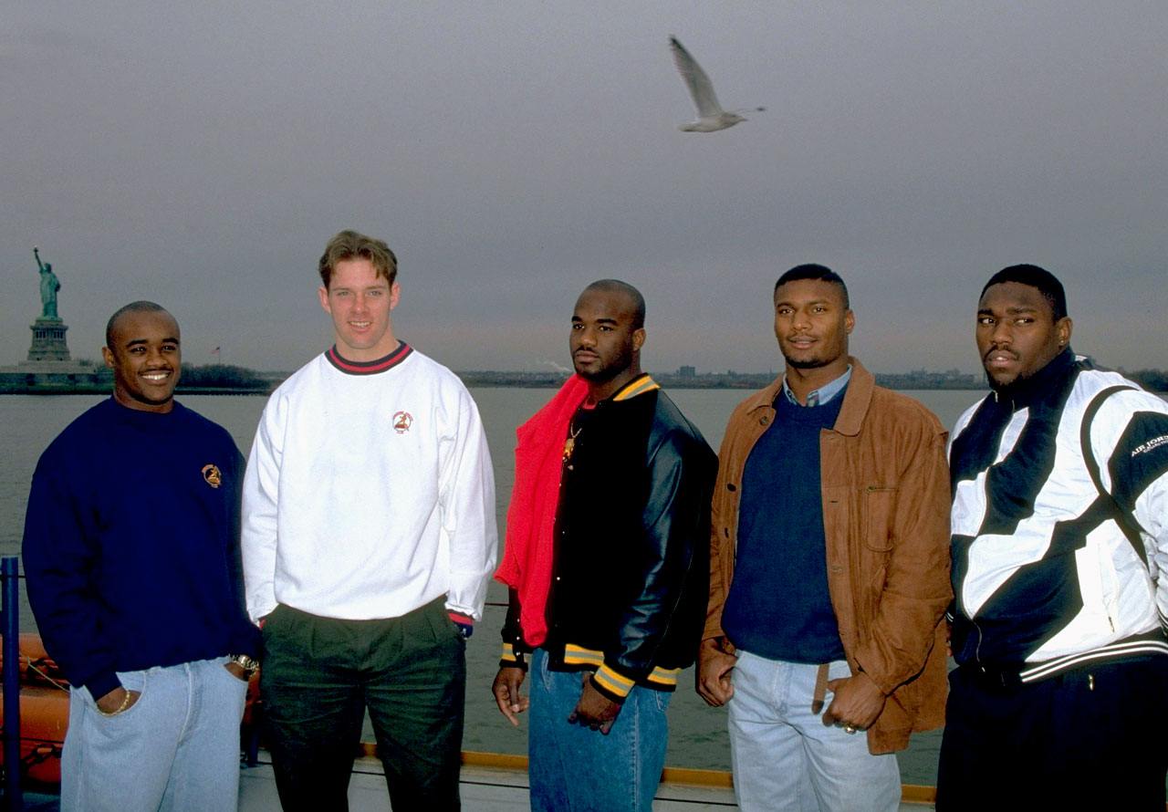 Heisman Trophy candidates Ki-Jana Carter and Kerry Collins (Penn State), Rashaan Salaam (Colorado), Steve McNair (Alcorn State), and Warren Sapp (Miami) pose together on the Staten Island Ferry on Dec. 10, 1994 in New York City. Rashaan Salaam would go on to win the award.