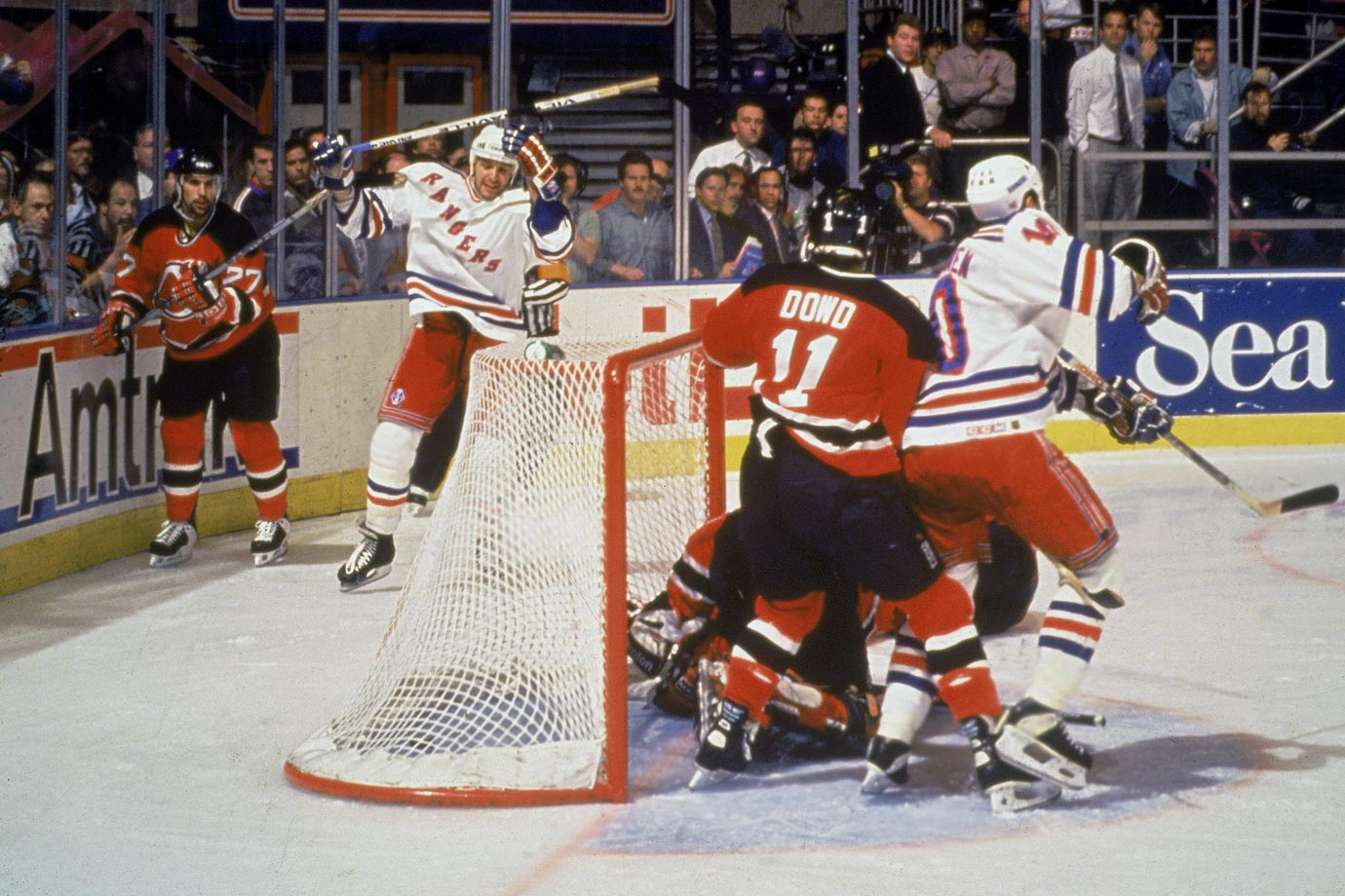 "Mark Messier's famous guarantee of a Rangers victory in Game 6 set up this nail-biting defensive battle. New York led 1-0 until the Devils tied the game with only 7.7 seconds left in regulation at Madison Square Garden. The winner was scored on Devils goalie Martin Brodeur by Stephane Matteau (32) at 4:21 of the second extra session -- his second double-OT goal of the series. Rangers fans will never forget broadcaster Howie Rose's cries of ""Matteau! Matteau!"""
