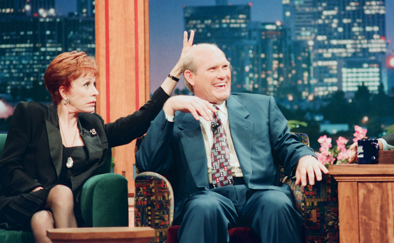 "Carol Burnett gives Terry Bradshaw the ""bunny ears"" during the taping of ""The Tonight Show with Jay Leno"" in 1994."