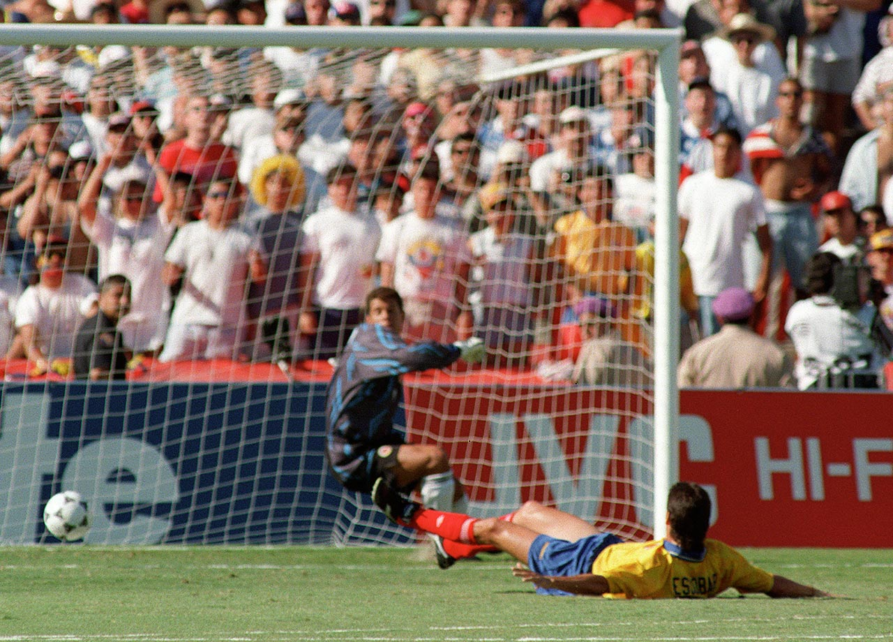 Andrés Escobar despairs after scoring an own goal against the United States in the 1994 World Cup.  A few days later, Escobar was killed by drug lords in his native Colombia.