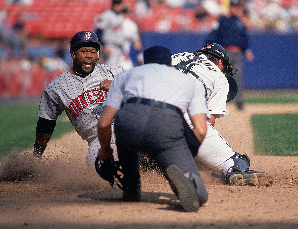 Kirby Puckett slides into home safe past Brewers catcher Dave Nilsson.