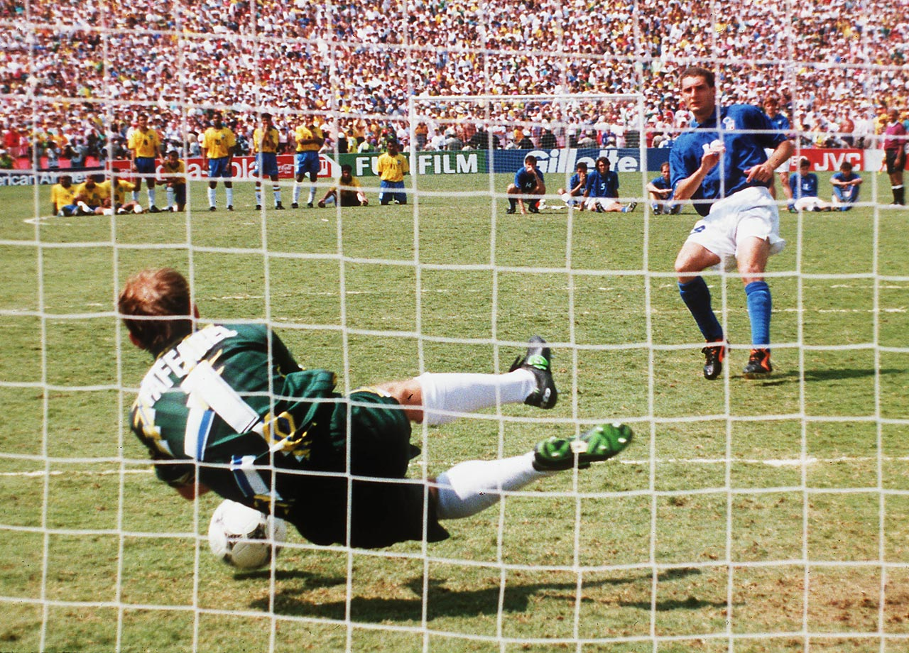 Brazilian goalkeeper Taffarel saves Daniele Massaro's shot during the penalty shootout in the 1994 World Cup final.