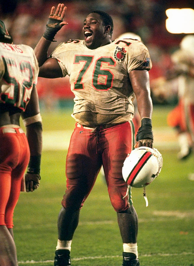 Warren Sapp celebrates a play during the Orange Bowl game between Miami and Nebraska on Jan. 1, 1995 in Miami. Nebraska won the game, 24-17.