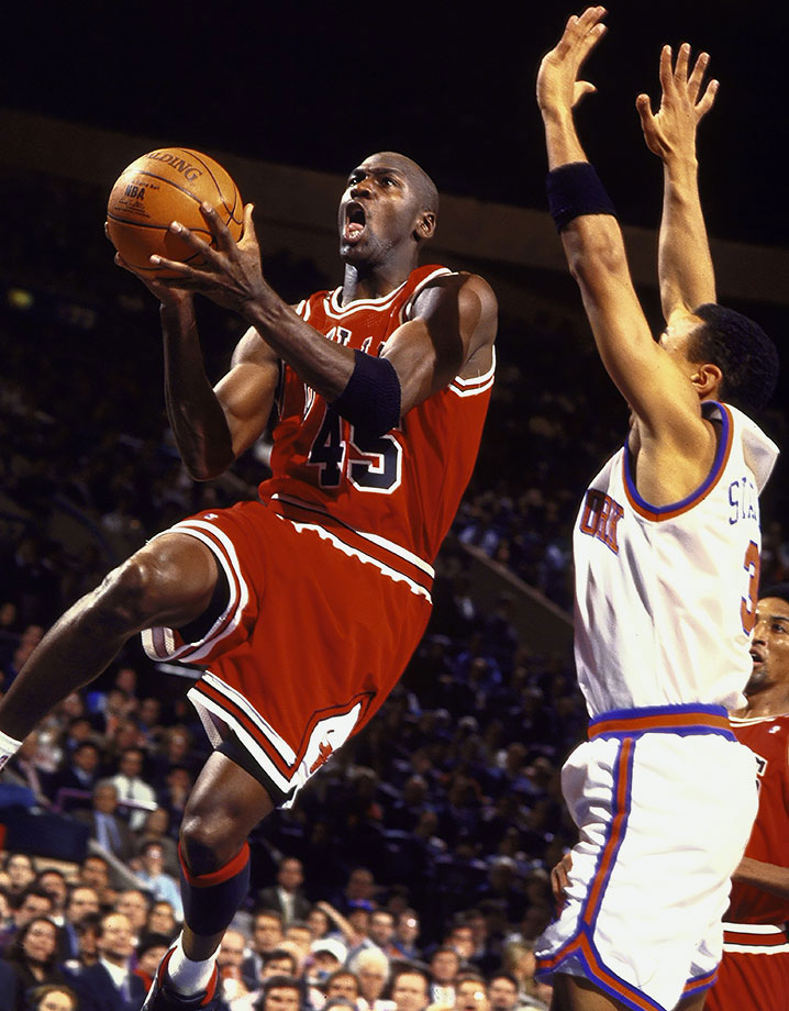 Michael Jordan cuts to the rim against the New York Knicks in March 1995, his fifth game after returning from his first retirement. In addition to his 55 points, Jordan fed Bill Wennington for the game-winner in the Bulls' 113-111 victory at Madison Square Garden.