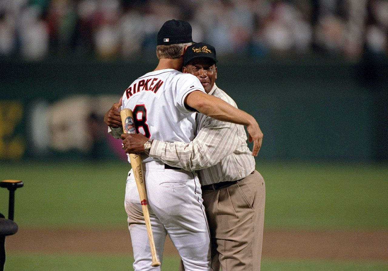 Ernie Banks hugs Cal Ripken Jr. after Ripken tied Lou Gehrig's record of 2,130 consecutive games played.