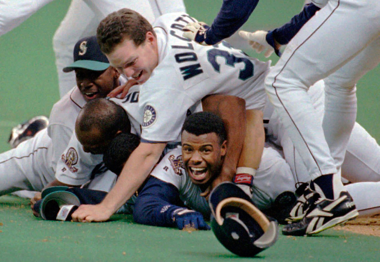 In 1995, the Mariners looked like they may be headed out of Seattle, until an electrifying playoff run, keyed by Ken Griffey Jr., helped land them approval for a new ballpark. In the division series against the Yankees, Griffey hit five home runs and scored the series-winning run in the 12th-inning of a do-or-die Game 5. He was mobbed by his delirious teammates.