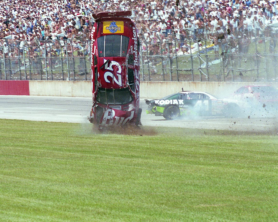 With 50 laps  to go Ken Schrader gets clipped by teammate Jeff Gordon off of turn two and flips wildly through the grass. In the ensuing mayhem, Bobby Labonte, Chuck Bown, Ricky Craven, John Andretti, Todd Bodine, and several others pile up on the track. In all, 13 cars are involved.