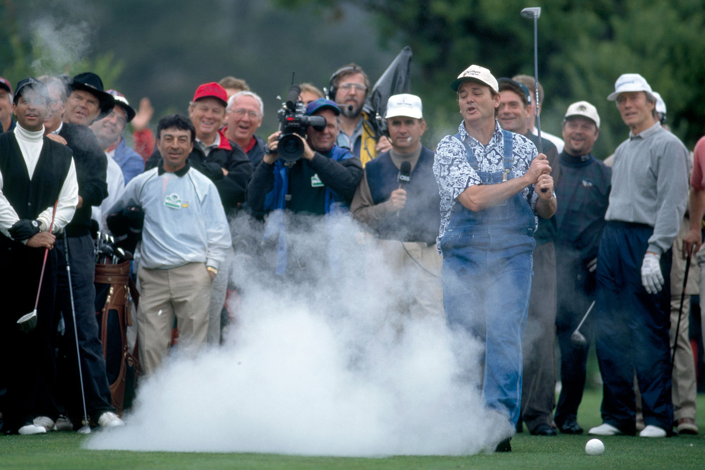 Bill Murray hits a fake golf ball which explodes in a cloud of smoke during during the 1996 AT&T Pebble Beach National Pro-Am golf tournament at Pebble Beach, Calif.