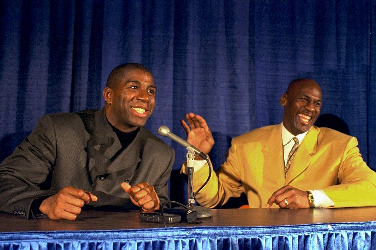 Michael Jordan laughs with Magic Johnson during a post-game press conference after a Bulls-Lakers game in February 1996 in Los Angeles.