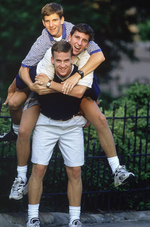 Peyton Manning carries his brothers Cooper and Eli on his back.