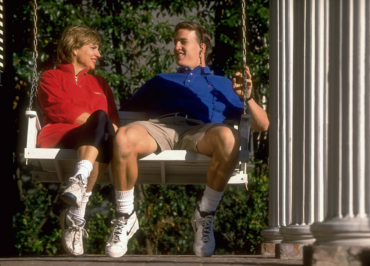 Peyton Manning sits on a porch swing with his mom Olivia at their home in New Orleans.