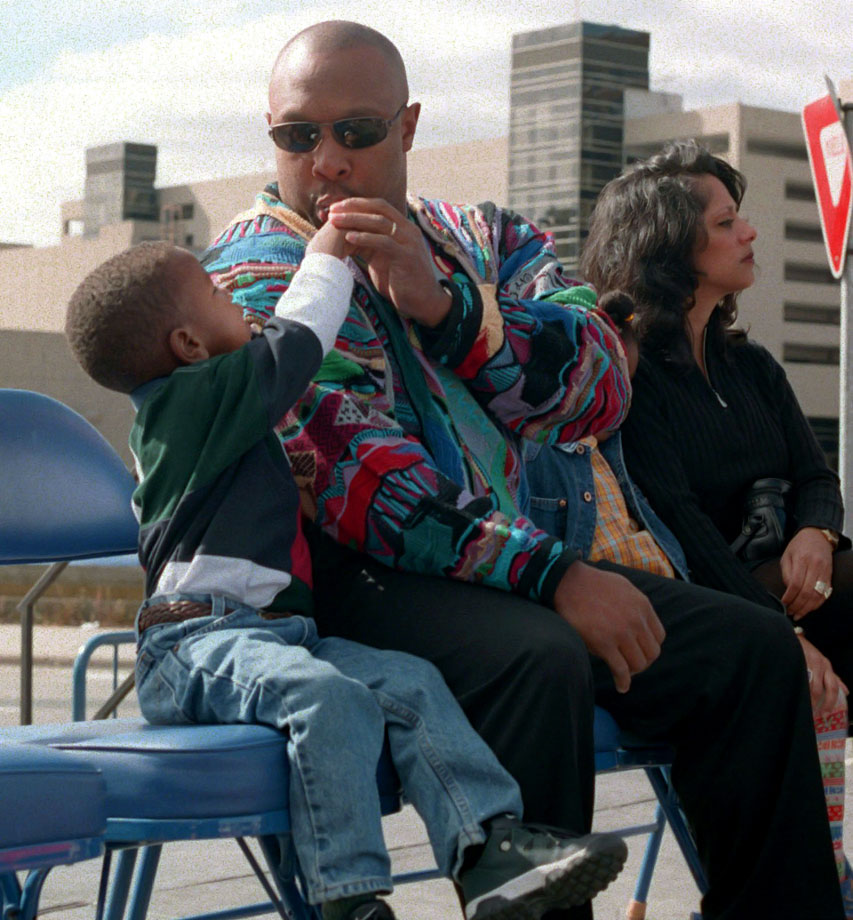 Kirby Puckett Jr. offers his dad a bite of candy during a ceremony to rename a block of Chicago Avenue in downtown Minneapolis Kirby Puckett Place.