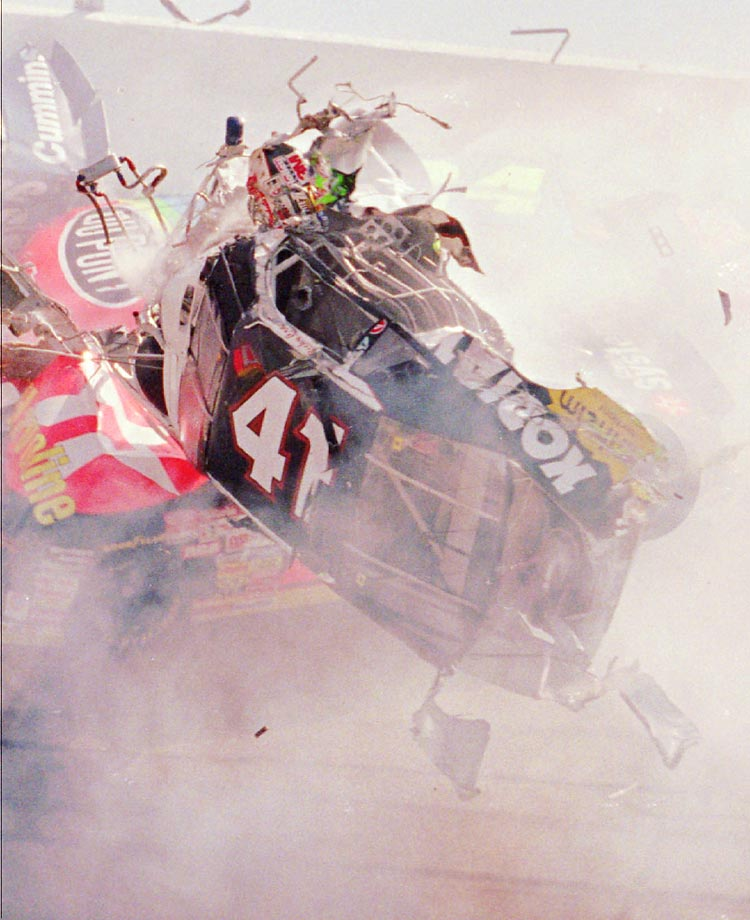 Ricky Craven takes a scary ride in this wreck in turn one at Talladega during the spring. His car was launched into the catch fencing as the pack passed him below. Mind boggling wreck.