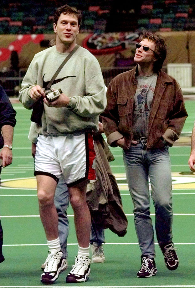New England Patriots quarterback Drew Bledsoe talks with Jon Bon Jovi before the teams' practice for Super Bowl XXXI against the Green Bay Packers at the Superdome in New Orleans.