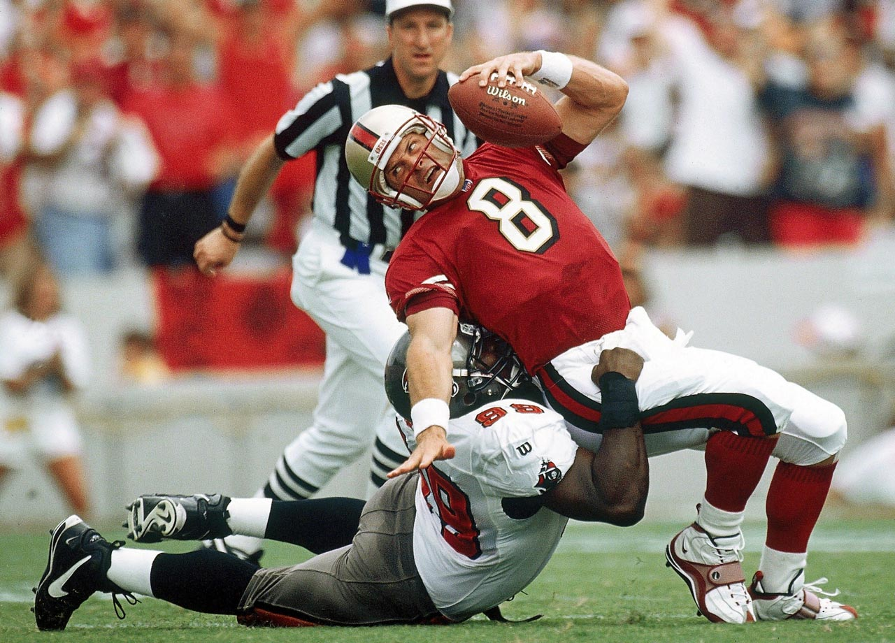 Warren Sapp sacks Steve Young during the Tampa Bay Buccaneers game against the San Francisco 49ers on Aug. 31, 1997 in Tampa, Fla. The Bucs won the game, 13-6.
