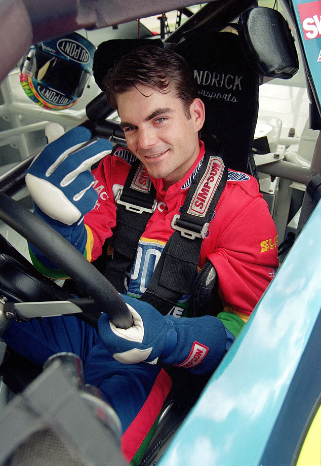 Jeff Gordon poses in his car before a race in Charlotte, N.C.