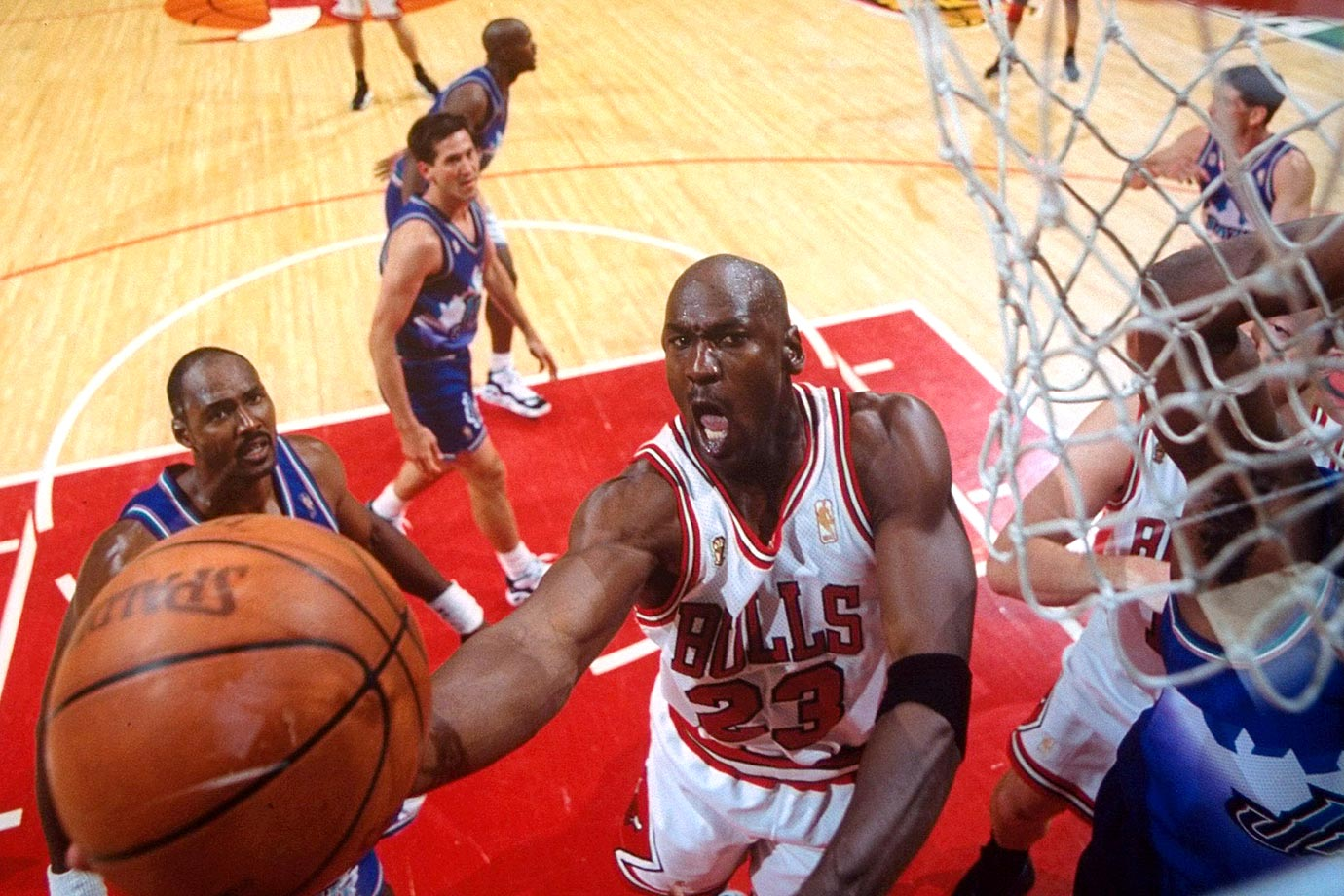 Michael Jordan takes the ball to the hoop against the Utah Jazz in Chicago in the 1997 NBA Finals. The Bulls won all three games of the series at the United Center, including Game 1, in which Jordan hit a game-winning 20-footer at the buzzer.