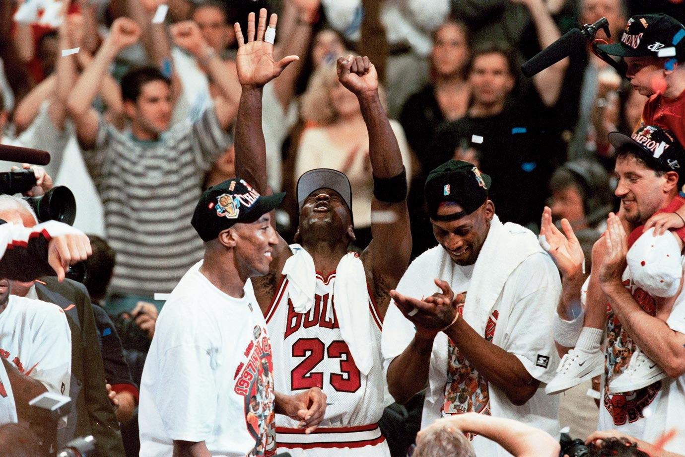 Michael Jordan, Scottie Pippen and Dennis Rodman soak in the cheers at the United Center. The trio won three NBA titles together.