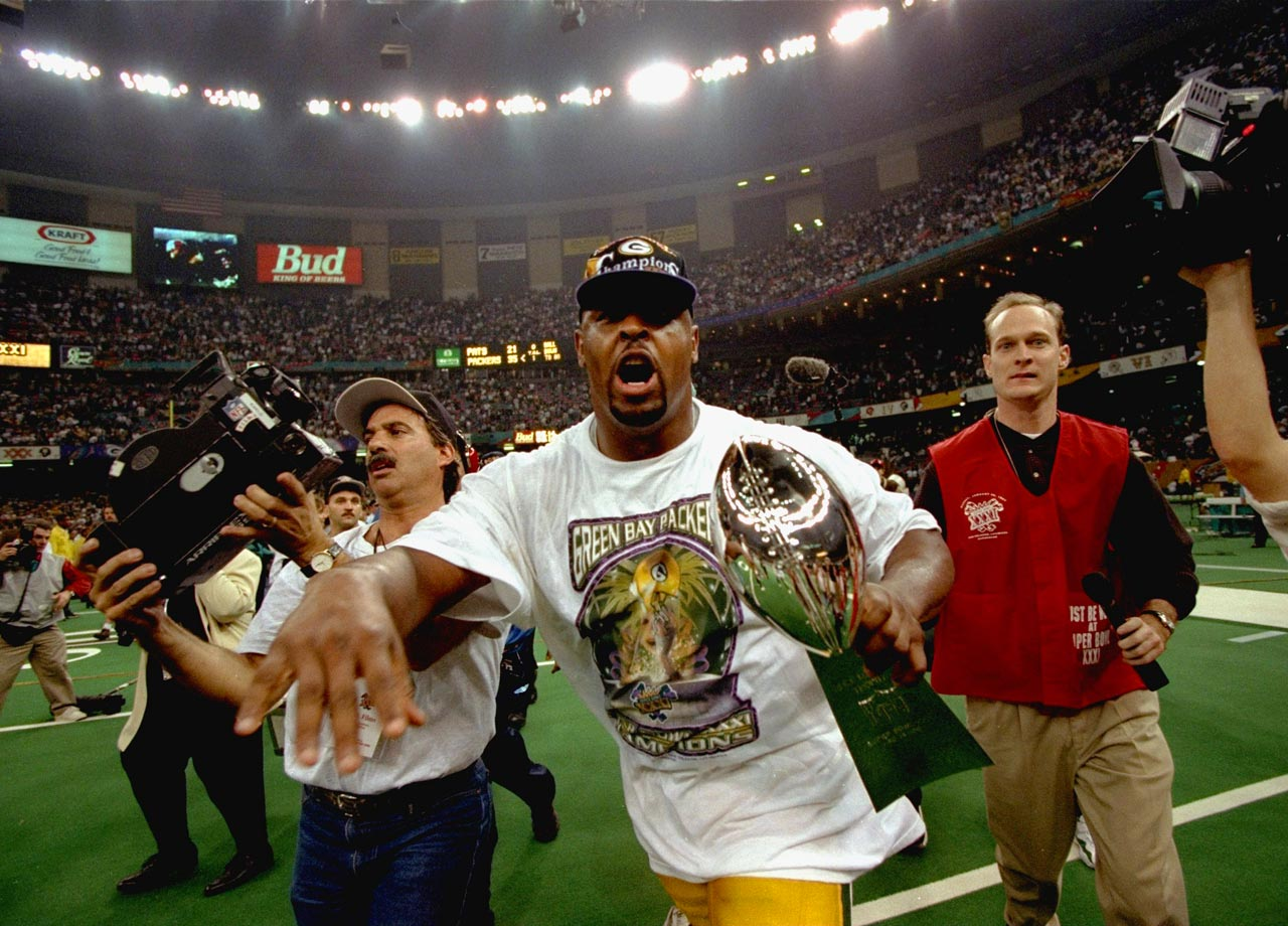 Green Bay Packers DE Reggie White celebrates with the Vince Lombardi Trophy after the Packers' 35-21 victory over the New England Patriots in Super Bowl XXXI on Jan. 26, 1997 in New Orleans.
