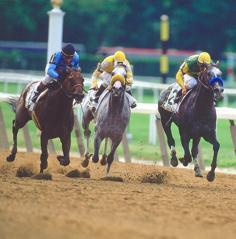 It looked like trainer Bob Baffert was about to put an end to the Triple Crown curse with Silver Charm (right). The gray colt had the lead down the Belmont stretch and the Crown in sight. But a late rush by Touch Gold (left) was just enough to steal the race — by 3/4 of a length.