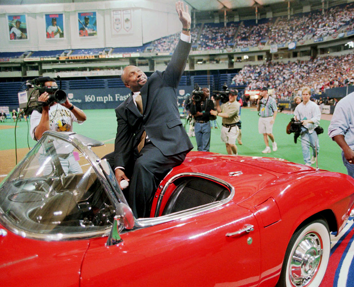Kirby Puckett waves to the crowd from inside a red Corvette convertible given to him by the Twins organization during a ceremony to retire his No. 34, prior to the Twins game against the Athletics in Minneapolis, Minn.