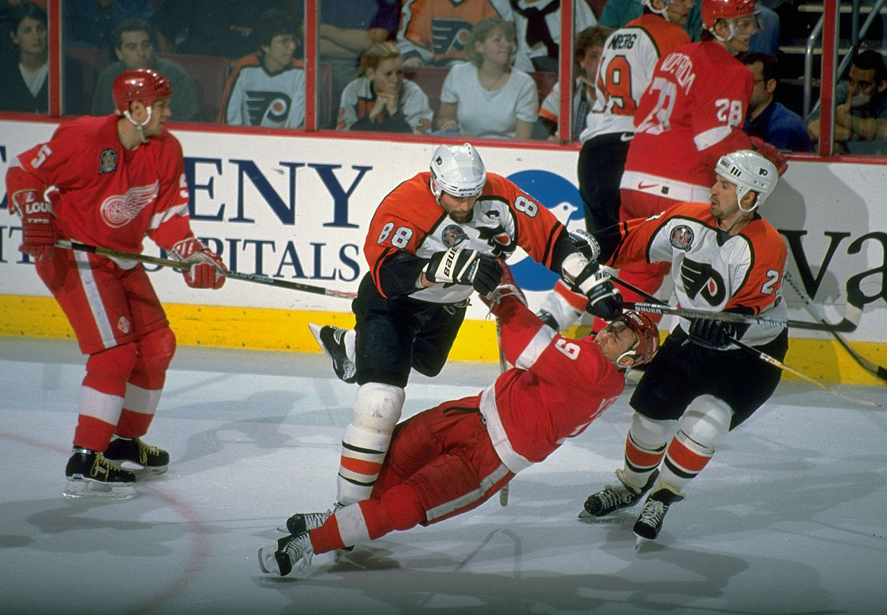 In a meeting of captains, Detroit's Steve Yzerman got the worst of his collision with Philadelphia's Eric Lindros during the opening game of the '97 final in Philadelphia. Yzerman survived and his team thrived, sweeping the Flyers and winning Detroit's first Stanley Cup in 42 years.