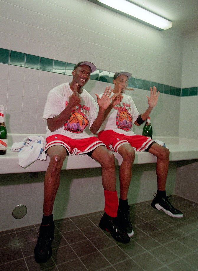Michael Jordan and Scottie Pippen hold up six fingers after winning their sixth championship following Game 6 of the 1998 NBA Finals between the Chicago Bulls and Utah Jazz.