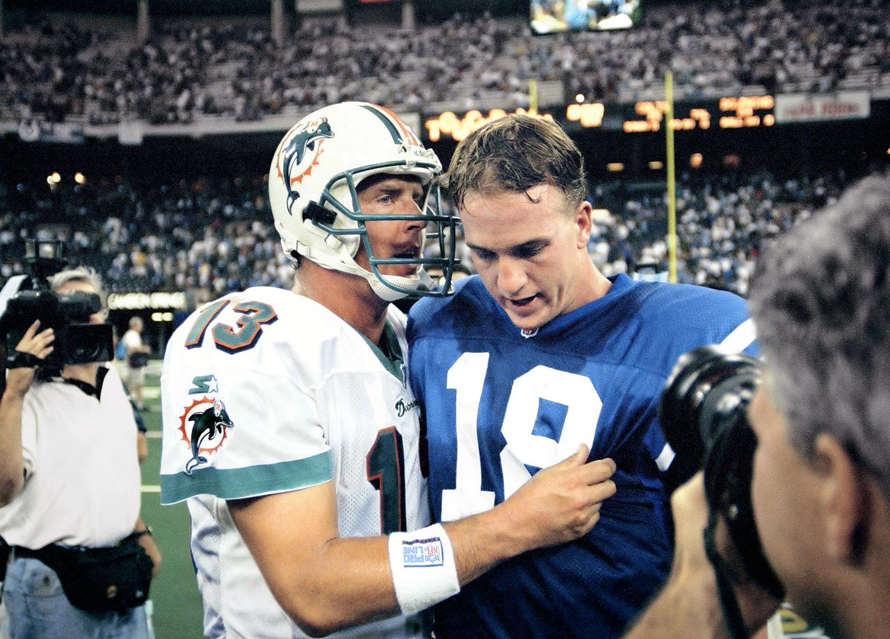 Dan Marino talks with rookie Peyton Manning following Manning's first career game in the Miami Dolphins 24-15 win over the Indianapolis Colts at the RCA Dome in Indianapolis on Sept. 6, 1998.