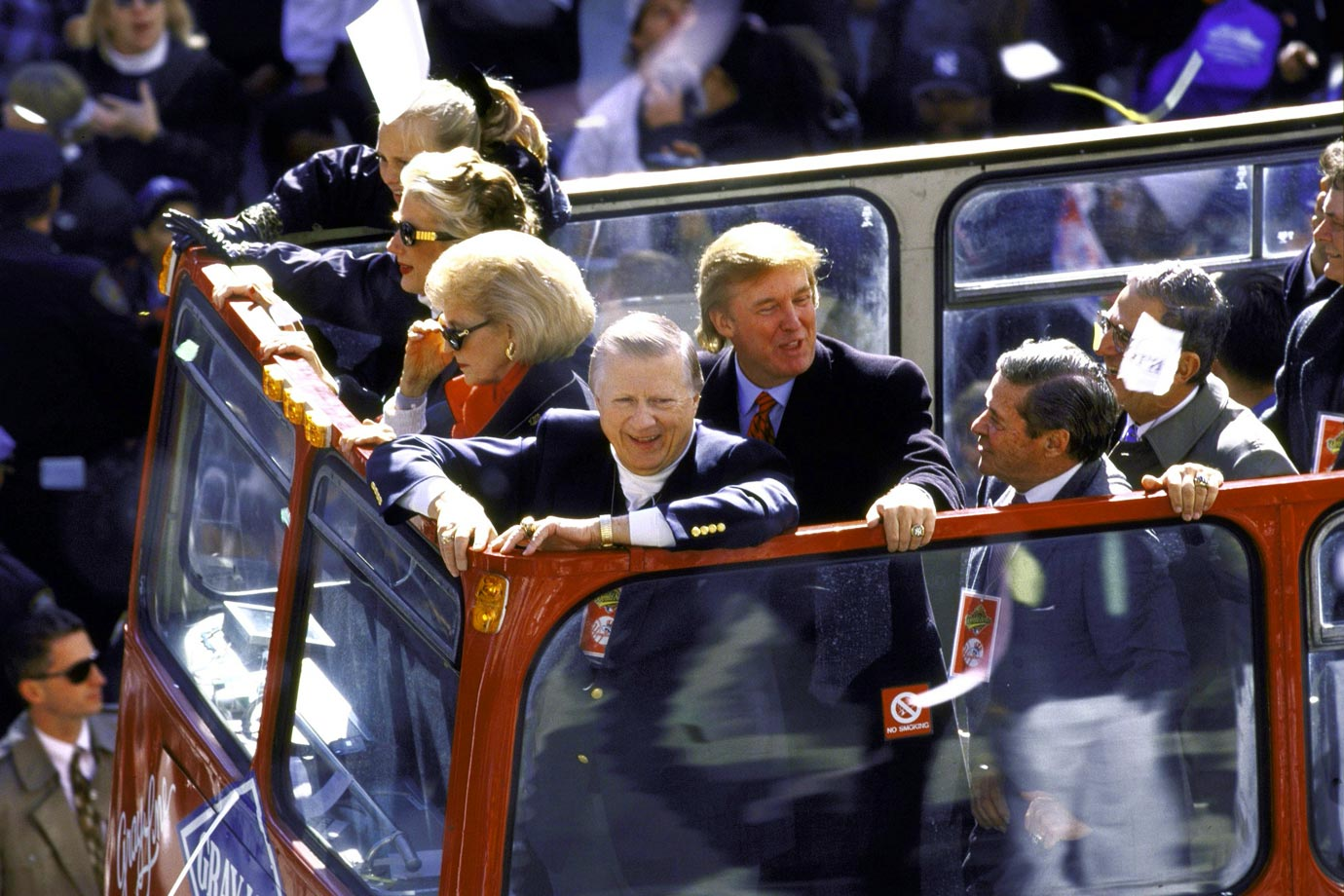 George Steinbrenner, his wife Joan and Donald Trump celebrate aboard a bus during a ticker tape parade on Broadway for the New York Yankees' World Series victory, on Oct. 23, 1998 in New York City.