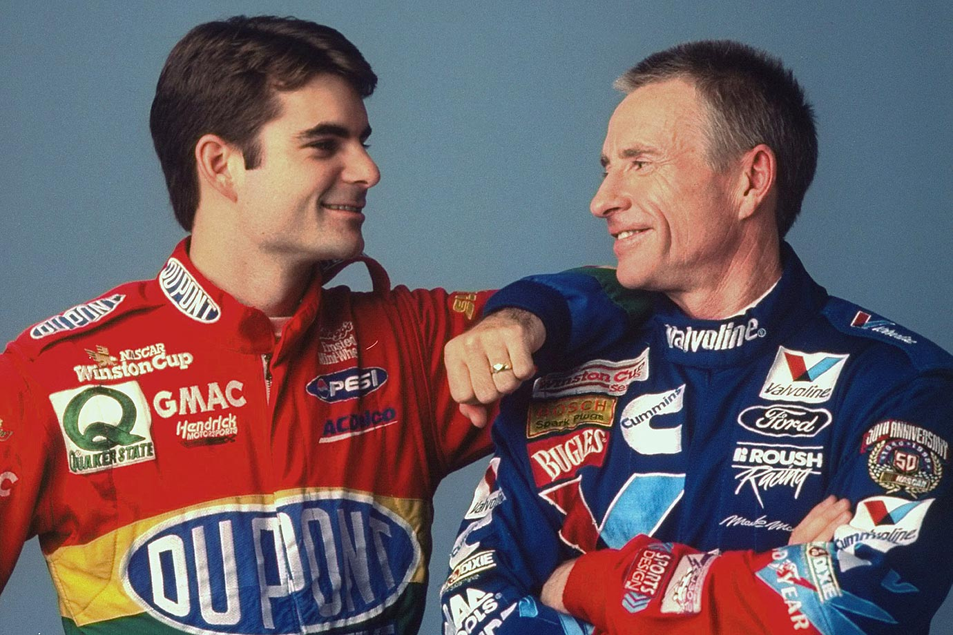 Jeff Gordon and Mark Martin smile during a photo shoot in Daytona Beach, Fla.