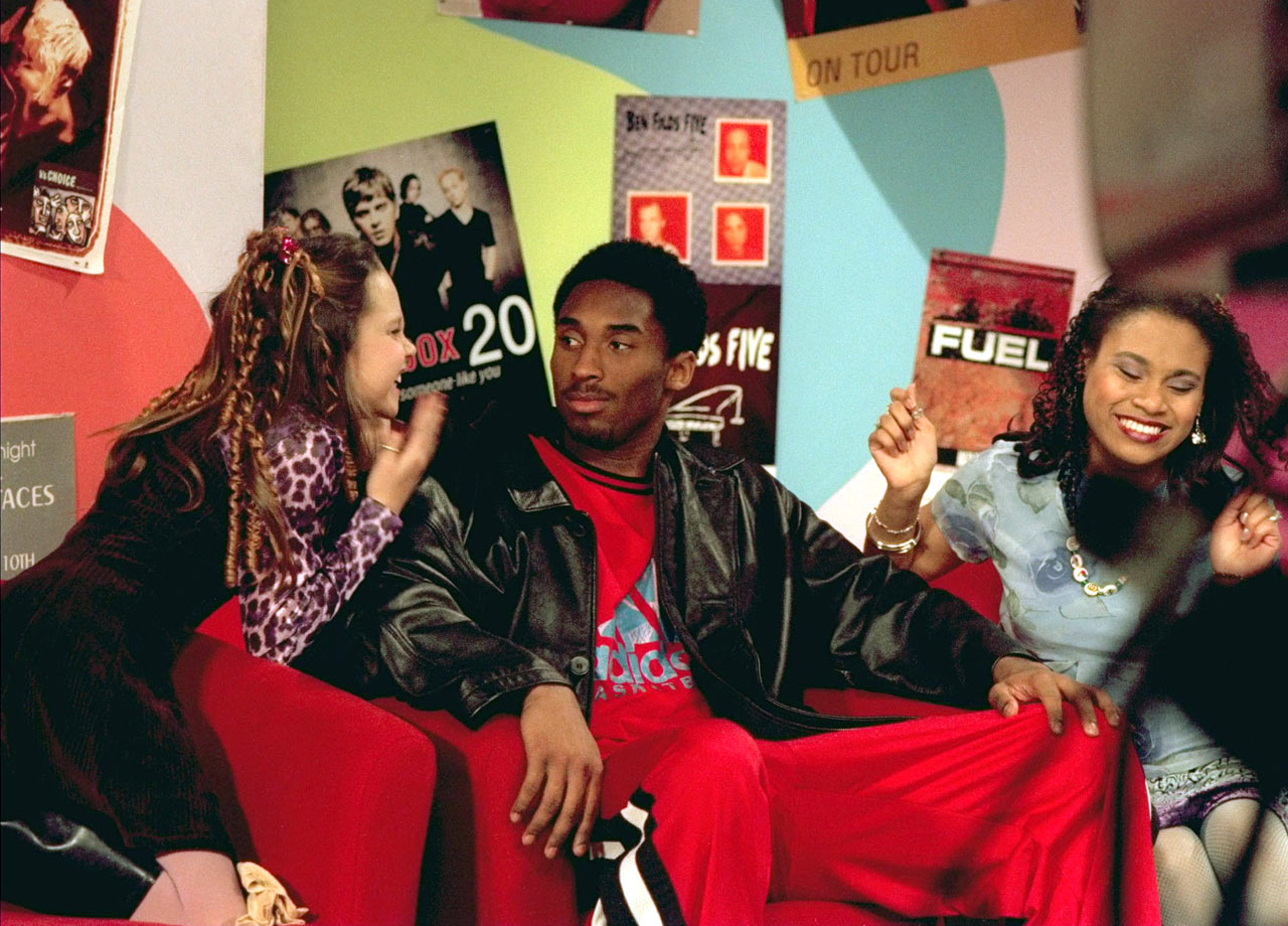 "Kobe looks concerned as Amanda Bynes acts a little crazy during taping of the show ""All That"" in 1998."