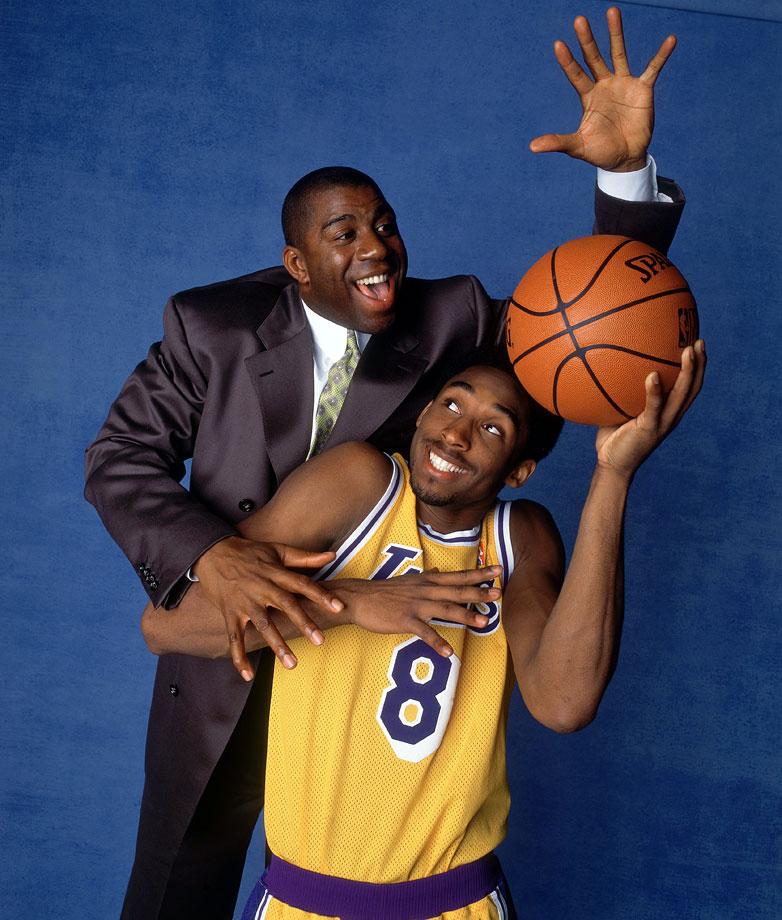 Kobe poses with Magic Johnson during this photo shoot in 1998.