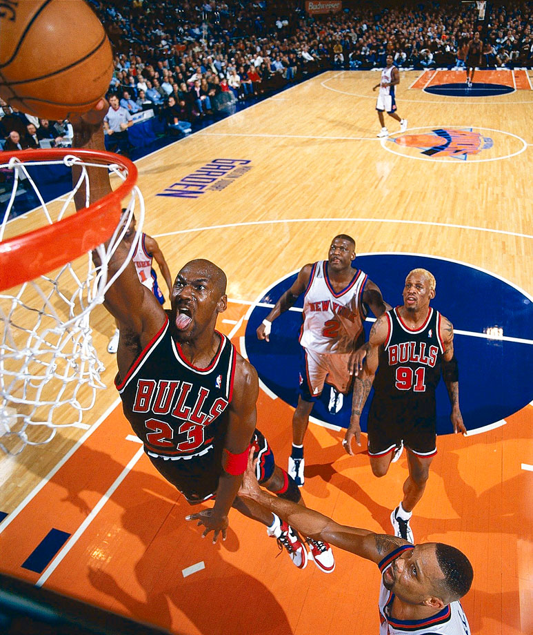 Michael Jordan throws down a dunk against the New York Knicks in March 1998. Jordan dominated the Knicks in the Bulls' 102-89 victory, amassing 42 points, eight rebounds, six assists and three steals.