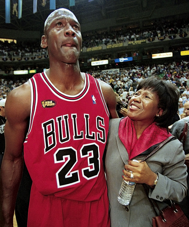 Michael Jordan wraps his arm around his mother, Deloris, after defeating the Utah Jazz in Game 6 of the 1998 NBA Finals to wrap up his sixth championship. In the final 41.9 seconds, Jordan made a layup, stole the ball from Karl Malone and hit a game-winning jumper from the top of the key to bring the Bulls back from a three-point deficit.