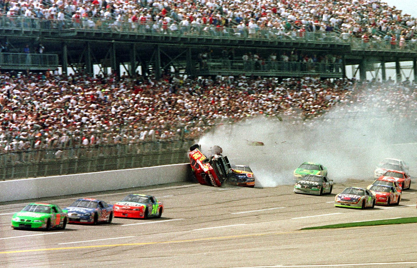 Ward Burton nudges Dale Earnhardt into Bill Elliot and then all hell breaks loose. What was an orderly race a few moments earlier is suddenly nothing more than a flock of wildly spinning cars in an impenetrable cloud of smoke. Amazingly, the only injury was Earnhardt's singed mustache.
